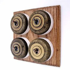 Reeded Round Dolly Light Switch on Wooden Base Antique Satin Brass 4 Gang