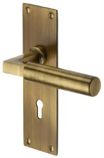 Heritage Bauhaus Door Lock Handles BAU7300  Antique Brass Lacq