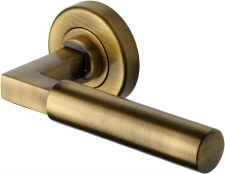 Heritage Bauhaus Round Rose Door Handles V2259 Antique Brass Lacq