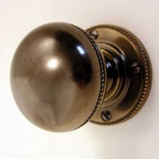 Beaded Bun Door Knobs Antique Brass Unlacquered