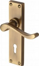 Heritage Bedford Door Lock Handles V810 Antique Brass Lacquered