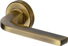 Heritage Bellagio Rnd Rose Door Handles V2015 Antique Brass Lacq