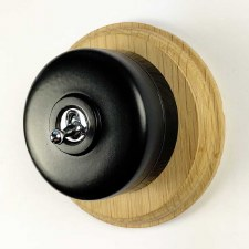 Round Dolly Light Switch Black on Circular Oak Base with Black Mount