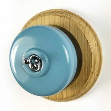 Round Dolly Light Switch Blue on Circular Oak Base with Black Mount