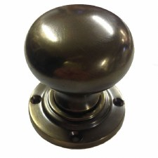 Aston Bun Door Knobs Antique Brass Unlacquered