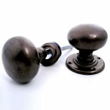 Aston Bun Rim Door Knobs Rustic Solid Bronze