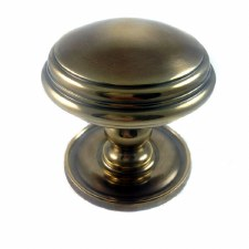Aston Centre Door Knob Stepped Antique Brass Unlacquered
