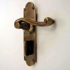 Aston Victorian Scroll Bathroom Door Handles Antique Brass Unlacquered