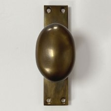 Aston Oval Outdoor Door Knob on Plate Antique Brass Unlacquered
