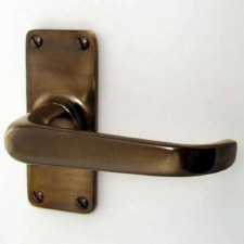 Aston Door Handles Short Plate Antique Brass Unlacquered