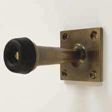Aston Door Stop Wall Mounted Antique Brass Unlacquered