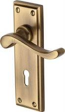 Heritage Edwardian Door Lock Handles W3200 Antique Brass Lacquered