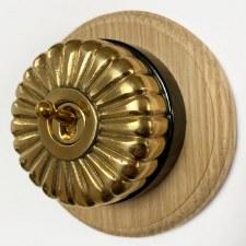 Fluted Round Dolly Light Switch on Round Oak Base Polished Brass