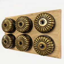 Fluted Round Dolly Light Switch on Wooden Base Antique Satin Brass 6 Gang