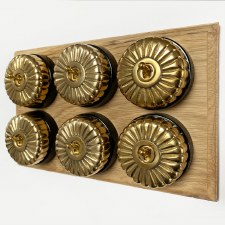 Fluted Round Dolly Light Switch on Wooden Base Polished Brass 6 Gang