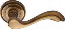 Heritage Lisboa Round Rose Door Handles V1601 Antique Brass Lacq