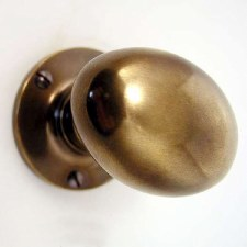 Aston Oval Door Knobs Antique Brass Unlacquered 59mm