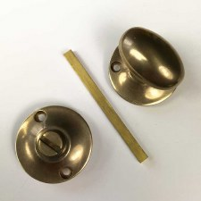 Aston Oval Thumb Turn & Release Antique Brass Unlacquered