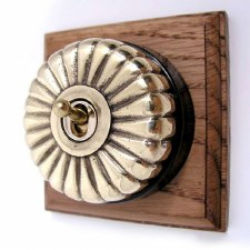 Fluted Round Dolly Light Switch on Wooden Base Polished Brass 1 Gang