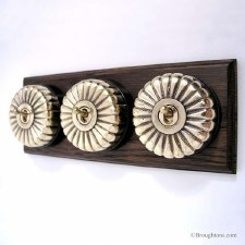Fluted Round Dolly Light Switch on Wooden Base Polished Brass 3 Gang
