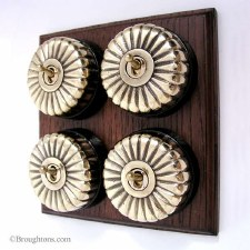Fluted Round Dolly Light Switch on Wooden Base Polished Brass 4 Gang