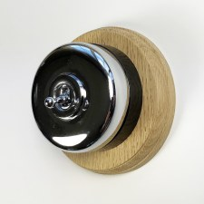 Round Dolly Light Switch on Circular Oak Base Chrome on Black Mount