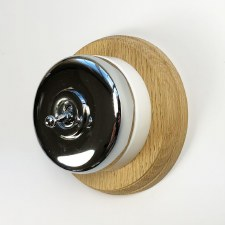 Round Dolly Light Switch on Circular Oak Base Chrome on White Mount