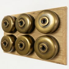 Round Dolly Light Switch on Oak Base 6 Gang Antique Satin Brass