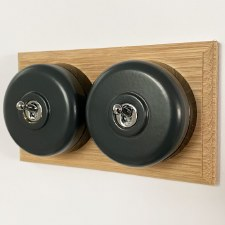 Round Dolly Light Switch 2 Gang Dark Grey on Oak Pattress with Black Mounts