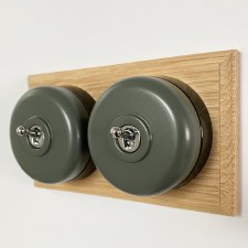 Round Dolly Light Switch 2 Gang Light Grey on Oak Pattress with Black Mounts