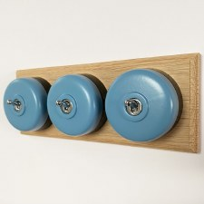 Round Dolly Light Switch 3 Gang Blue on Oak Pattress with Black Mount