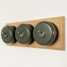 Round Dolly Light Switch 3 Gang Light Grey on Oak Pattress with Black Mount