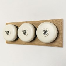 Round Dolly Light Switch 3 Gang White on Oak Pattress with Black Mount