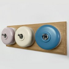 Round Dolly Light Switch 3 Gang Mix and Match on Oak Pattress with White Mounts