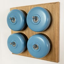 Round Dolly Light Switch 4 Gang Blue on Oak Pattress with Black Mounts