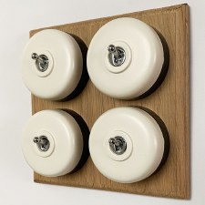 Round Dolly Light Switch 4 Gang White on Oak Pattress with Black Mounts