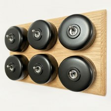 Round Dolly Light Switch 6 Gang Black on Oak Pattress with Black Mounts