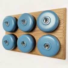Round Dolly Light Switch 6 Gang Blue on Oak Pattress with Black Mounts