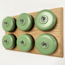 Round Dolly Light Switch 6 Gang Green on Oak Pattress with Black Mounts