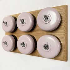 Round Dolly Light Switch 6 Gang Lilac on Oak Pattress with Black Mounts