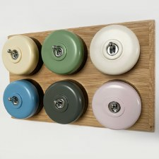 Round Dolly Light Switch 6 Gang Mix and Match on Oak Pattress with Black Mounts