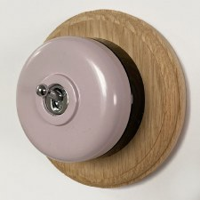 Round Dolly Light Switch Lilac on Circular Oak Base with Black Mount