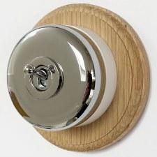 Round Dolly Light Switch on Circular Oak Base Polished Chrome