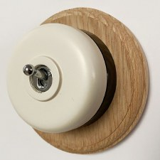 Round Dolly Light Switch White on Circular Oak Base with Black Mount