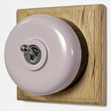 Round Dolly Light Switch Lilac on Square Oak Pattress with Black Mount
