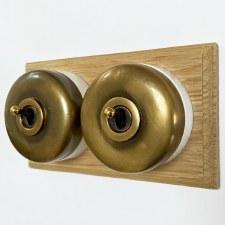 Round Dolly Light Switch on Oak Base Antique Satin Brass 2 Gang