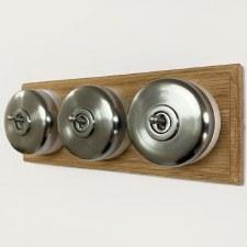 Round Dolly Light Switch on Oak Base Satin Chrome 3 Gang
