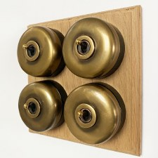 Round Dolly Light Switch on Oak Base Antique Satin Brass 4 Gang