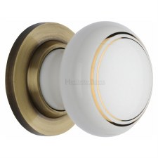 Heritage Porcelain Door Knobs White & Gold Line with Antique Brass Rose