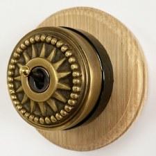 Star Round Dolly Light Switch on Circular Oak Base Antique Satin Brass 1Gang